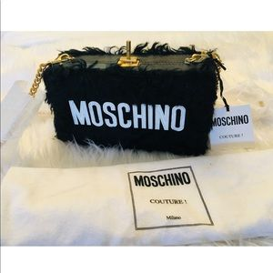 Moschino clutch with chain. Made in Italy